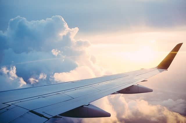 A wing of an airplane, getting you to a new country before dealing with culture shock.