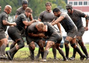 Rugby players in mud