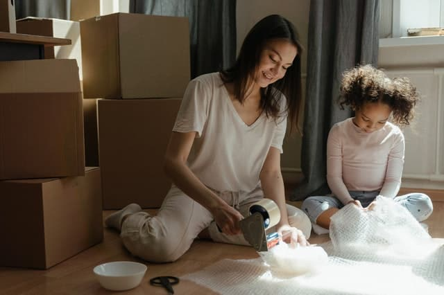 Woman and child preparing shipping of household items to Australia